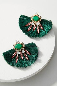 Bold green gem and fringe party statement earrings via Anthropologie