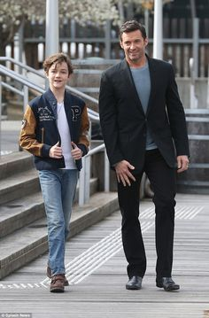 Hugh Jackman looks dapper as he walks alongside his young co-star Levi Miller for a photo call in Melbourne. via MailOnline