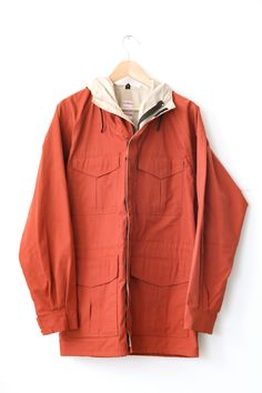 orange raincoat- perfect to pop out in those fall rainy days.