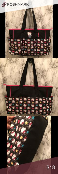 ffb19ecb40 Hello Kitty diaper bag This black bag features Hello Kitty s face  throughout. The last picture