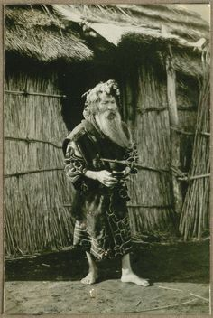 Aino outside his house; in his hand, he is holding ceremonial eating (drinking?) tools. | by National Museum of Denmark