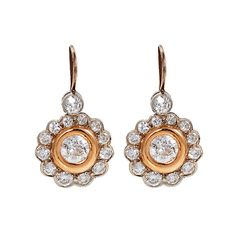 Diamond Yellow and White Gold Flower Earrings | From a unique collection of vintage dangle earrings at https://www.1stdibs.com/jewelry/earrings/dangle-earrings/