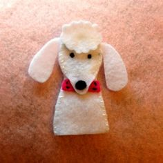 Puppy Finger Puppets - Poodle  There are a lot of finger puppet patterns.