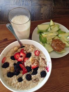 over night oats topped with strawberries and black berries and a tbs of PB with a side of sliced granny smith apples and PB with a tall cold glass of almond milk