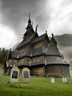 Spooky but neat. Wonder who's gravestones those are? Church in Norway
