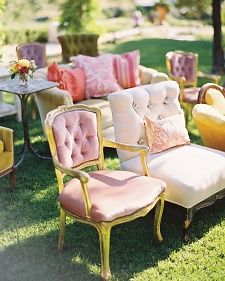 Seat guests in a mix of vintage settees and upholstered chairs