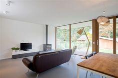Interieur strobalenwoning copyright: Henk Van Aelst #woonkamer open haard #strobalenbouw