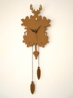 cardboard cuckoo clock 1  This Cucu, is made with recycled cardboard. The little bird is made with fluo clay.