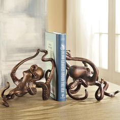 A truly unique way to display your favorite books, these Octopus Iron Bookends from SPI will add a coastal element to your den or library decor.