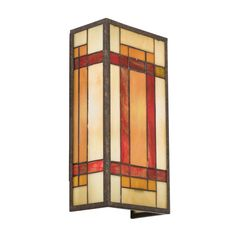 Looking to add a splash of color to your living room? Kichlers' casual Tiffany wall sconce in Patina Bronze will radiate tones of red, orange and yellow when lit!!