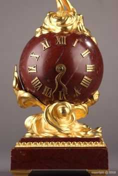 A red marble and ormolu 1900 small clock with nymph signed DORVAL