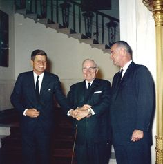 President John F. Kennedy stands with Truman and Johnson.
