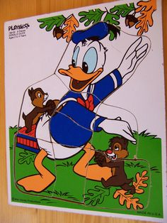 PlaySkool Puzzle - Donald Duck.     I have this one. (I won it in a coloring contest when I was around 5 yrs)    But, mine has Huey, Duey and Luey in the background.