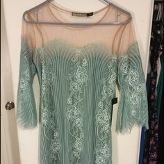 For love and lemons blue dress For Love and Lemons blue lace half sleeve dress with tan upper mesh perfect condition never worn! New with tags! Loves it just have not found an occasion to wear it yet! Beautiful blue green color! For Love and Lemons Dresses Mini