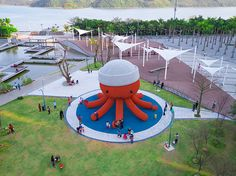 in a new seaside development in shenzhen, a larger-than-life sized creature sits in the center of a public park.