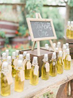 Homemade olive oil favors for a Tuscan inspired wedding: http://www.stylemepretty.com/2015/07/30/rustic-romantic-tuscan-inspired-vineyard-wedding/   Photography: Honey Honey - http://www.hoooney.com/