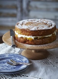 A delicious, moist cake with sweet citrus, roasted nuts and a lovely tart layer of apricot puree and clouds of cream. The syruped cakes can be kept for two days before assembling and serving.