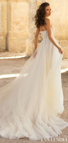 A-line tulle wedding dress style with a lace bodice, strapless sweetheart neckline and corset bodice for the romantic bride | Flowy bridal gown design Eva Lendel Wedding Dresses 2021- Golden Hour Collection - Kollet - Belle The Magazine See more gorgeous bridal gowns by clicking on the photo