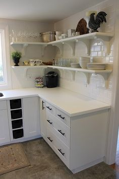Backsplash: White subway tile, Lowes Countertops: White Corian (the Allen/Lowes brand) Shelf materials (brackets, wood, trim): Home Depot Cabinets: Adel White, Ikea Cabinet Hardware: matte black pulls on sale at Lowes anexcellentadvent. White Corian Countertops, Formica Kitchen Countertops, Kitchen Backsplash, Home Depot Cabinets, Ikea Cabinets, Kitchen Cabinets, Storage Cabinets, White Cabinets, Ikea Kitchen Shelves