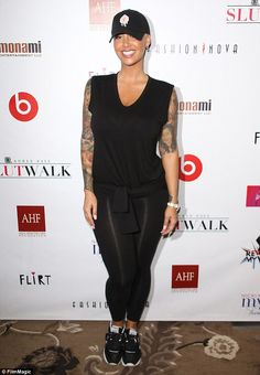 Monochrome magnificence: Amber Rose looked stunning in all black workout gear at her annual Slutwalk Festival in Los Angeles on Thursday