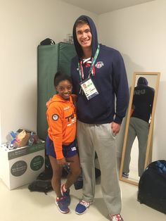Simone Biles and swimmer Nathan Adrian, both Gold Medalists. She's and he's They don't even look like real humans standing next to each other. Nbc Olympics, Rio Olympics 2016, Summer Olympics, Olympic Swimmers, Olympic Team, Olympic Games, Gymnastics Posters, Gymnastics Team, Gymnastics Quotes
