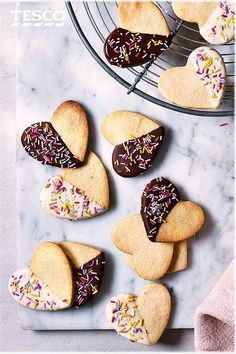 Easy to bake and even easier to eat, these cute and colourful vanilla heart biscuits, dipped in white and dark chocolate, are the ideal weekend baking project. The perfect easy but impressive Mother's Day gift | Tesco
