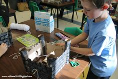 make a winch on the side to turn the pulley system to close the drawbridge