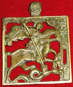 This is a 17th century cast bronze icon of Saint George and the Dragon.