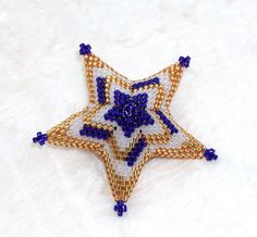 This tutorial gives step by step instructions and graphics to complete a three dimensional Star Ornament with a Flame Stitch Color Pattern. Delica seed beads are used to create this star ornament. Weave a simple pile of beads into a unique sculpture with a stunning color pattern.