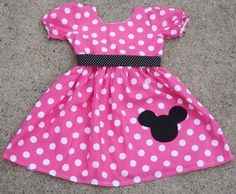 Dress up the birthday girl in a Minnie-inspired outfit for her big day — like this pink polka dot Boutique Minnie Mouse Dress ($40).