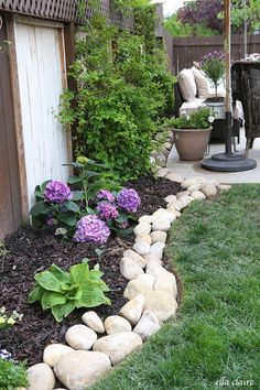 DIY River Rock Planter Border~ see all of the details at http://ellaclaireinspired.com