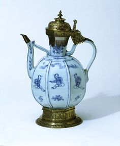 LavishShoestring.com | Ewer        Place of origin:        Jingdezhen, China (porcelain, made)      London, England (mounts, made)      Date:        1560-1586 (made)      Artist/Maker:        Unknown (production)      Materials and Techniques:        Porcelain, painted with underglaze blue, with gilt-metal mounts