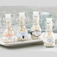Give each of your guests a cute way to store candy, mints, or nuts while decorating your event tables with a sense of style when you use Customizable Mini Champagne Bottle with Flip Cap.