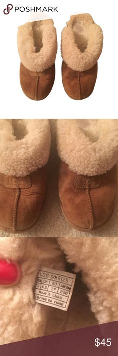 UGG Slippers Chestnut 100% authentic UGG Australia slippers. Super comfortable and warm. Please refer go the photos t o see the areas that show wear. Not very noticeable when worn at all, the inside of one shoe is a little worn but other than that great condition :) UGG Shoes Winter & Rain Boots