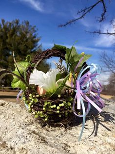 Ostara Spring Equinox Floral Blessing Basket - Welcome Spring and the Earth awakening with this beautiful, festive handmade Ostara Blessing Basket!   This cute little Ostara blessing basket features: a delicate pentacle charm, antique rose beads, feathers, silk flowers & ivy, pastel ribbons, a baby pinecone and ornamental eggs.
