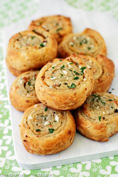 Puff Pastry Garlic Bread Roll-Ups ~ softened butter, fresh chopped garlic, parsley and parmesan are mixed together and smeared over a sheet of puff pastry then rolled up and briefly refrigerated, sliced and baked.