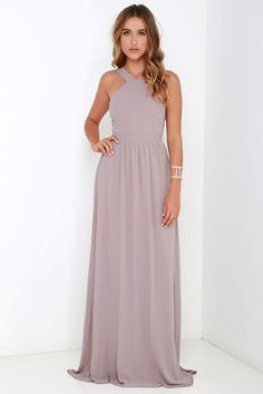 More romantic than a candlelit dinner or a trip to the Eiffel Tower, the Air of Romance Taupe Maxi Dress will have you feeling the love! Lightweight Georgette falls from a modified halter neckline, into a seamed bodice supported by semi-sheer shoulder straps. A sweeping skirt cascades from a banded waist completing this elegant maxi dress. Hidden zipper with clasp. Fully lined. 100% Polyester. Dry Clean Only. Imported.