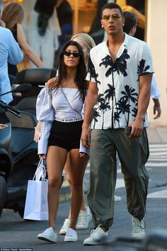 Kourtney Kardashian is certainly enjoying being footloose and fancy free while on an adults only trip with her toyboy Younes Bendjima.