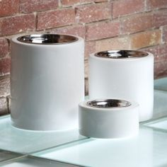 Lg: $108: High-rise Elevated Dog Feeders with High Gloss White- Simple yet practical and with a twist of contemporary, the High-rise Elevated Feeders in classic high-gloss white porcelain are a beautiful dining accent for any pet.
