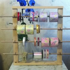 Ribbon holder. This space making idea cost me absolutely nothing to make. I used wood scraps my hubby had but now I can buy more ribbon and not worry about where to put it.