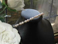 Cream Cultured Pearls and Preciosa Czech Crystals on Silver Tiara Band.