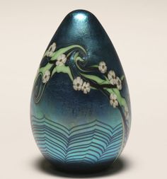 Orient & Flume art glass paperweight with trailing florals and a pulled feather design
