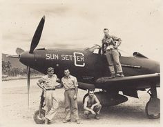 "The name in larger letters, ""Capt. Rasmussen,"" is the pilot; beneath it is the name of the crew chief, ""A. R. Trotta."" Many of the photos show a pilot (an officer, fully dressed, usually with a Mae West, sometimes with a holstered pistol, and occasionally headphones), and crew chief (a sergeant, either stripped to the waist or in overalls)."