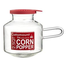 """Industrial-quality glass popper makes 2.5 quarts of popcorn while the special red silicone lid melts butter simultaneously.""  -- Brilliant.  With love from Crate and Barrel."