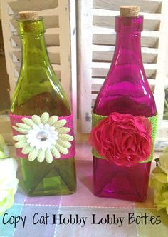 Easy & Pretty DIY Copy Cat Hobby Lobby Decor Bottles.  OP says: What you need: Colored glass bottles (you can get these at Hobby Lobby or may even score them at a thrift store or garage sale or if you're feeling crafty you can tint your own bottles).  Ribbon or burlap to wrap the bottle, Embellishments,  Hot glue gun. This is a simple project but it turns out so pretty & can be done  in literally about 10 minutes!  Me:  I didn't even know there is burlap ribbon!