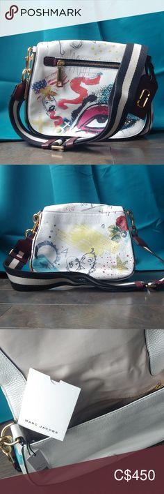Marc Jacobs Collage Saddle Bag Collage saddle bag printed with eye & symbol details. Golden hardware & removable strap. 9.5