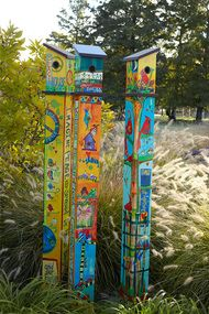 """This Birdhouse Pole features a fledgling ladder, a universal 1.5"""""""" hole, and holes for ventilation and drainage. Remove the rooftop screws for easy cleanout. It is a state-of-the-art reproduction of hand-painted and wood-burned cedar pole. The artwork is laminated onto a lightweight PVC pole for fade-resistance, durability, & reduced shipping cost. Easy to install. Hardware included. Patent pending. By Artist Stephanie Burgess of Painted Peace Dimensions: 6' x 6"""""""" x 6"""""""" Please note: Art…"""