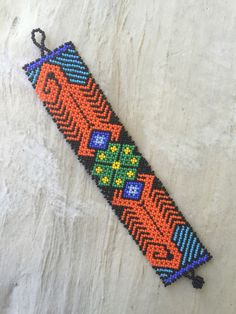 A personal favorite from my Etsy shop https://www.etsy.com/listing/246376271/beaded-huichol-bracelet-yellow