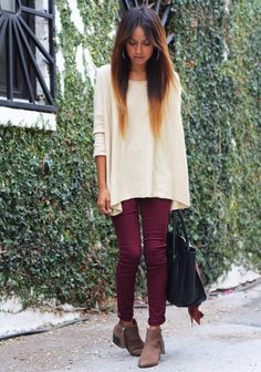 Maroon jeans, cream sweater, neutral boots, black bag.