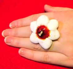 Ring with a ceramic flower.